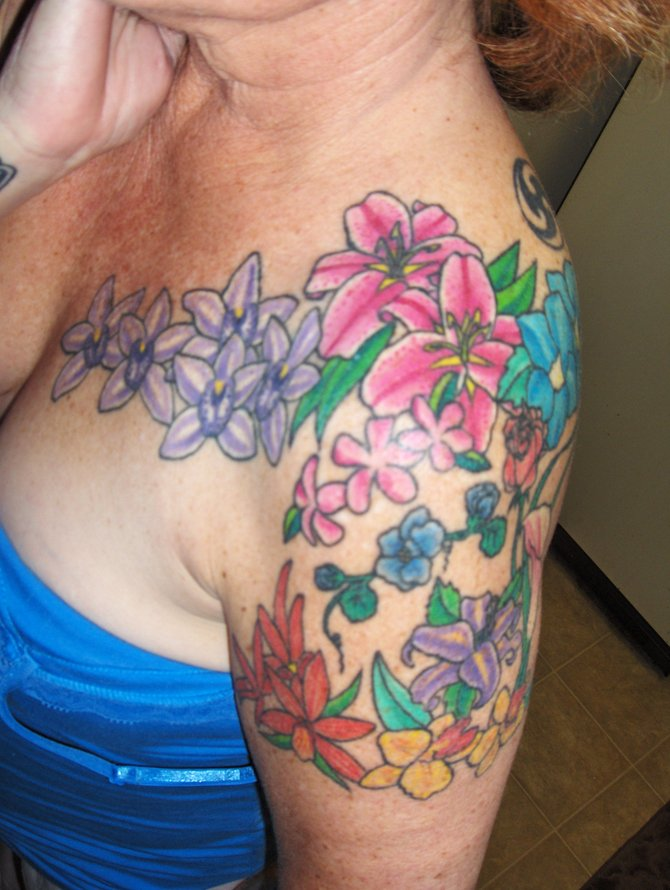 After a trip to Hawaii in 2005, I had this tattoo done by Heather Sinn at Avalon tattoo in Pacific Beach.  It represents all of the beautiful flowers so abundant on the island, plumeria being my favorite.  They have such a soothing, relaxing fragrance.