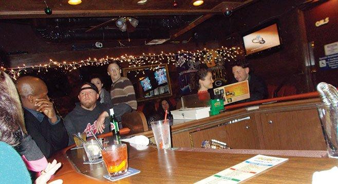 Folks around the bar.