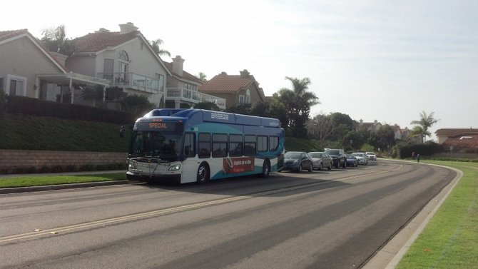 A North County Transit bus shuttled Coastal Commission staff and other participants, overflow participants trailed in their own cars