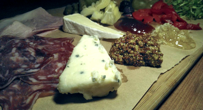 Sycamore Den's meat and cheese board.  The olives can stay, but everything else doesn't gel with the bar's cocktails.