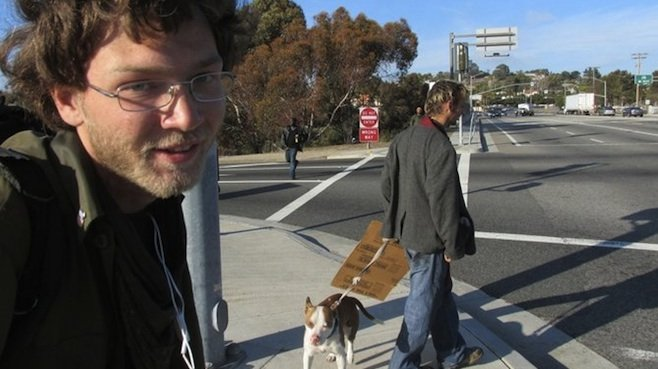 Freeway exit panhandlers Ian and Randall were threatened by the two men across the street.