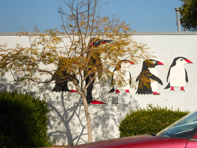 Colorful penguins grace the wall of Pacific Beach school.