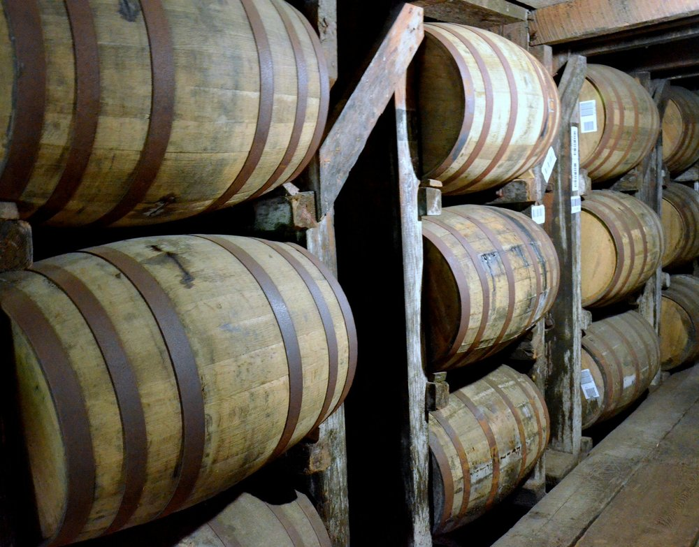 Kentucky bourbon aging in charred oak barrels.