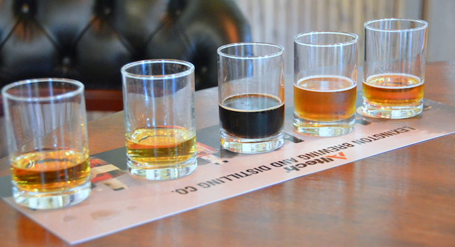 Bourbon, malt whiskey and beers ready for tasting at Lexington's Town Branch Distillery.