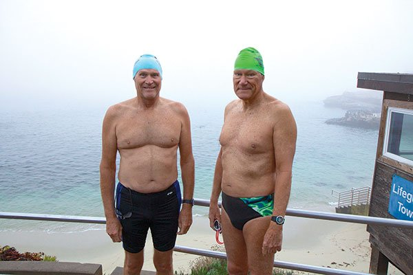 Drew Downs (left) and Richard Walker swim daily at dawn in La Jolla Cove. They were recently blocked by a large and aggressive sea lion who bared his teeth whenever they tried to enter the water.