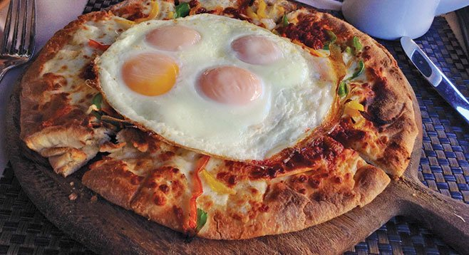 Authentic? No, but Bedford found Osteria Panevino's breakfast pizza to be a tasty bargain.