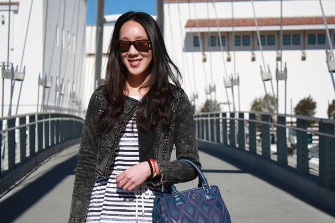 Jasmine Lu wearing a striped dress