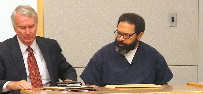 Patton with defendant Perez, who recently appeared with beard and glasses. Photo by Eva