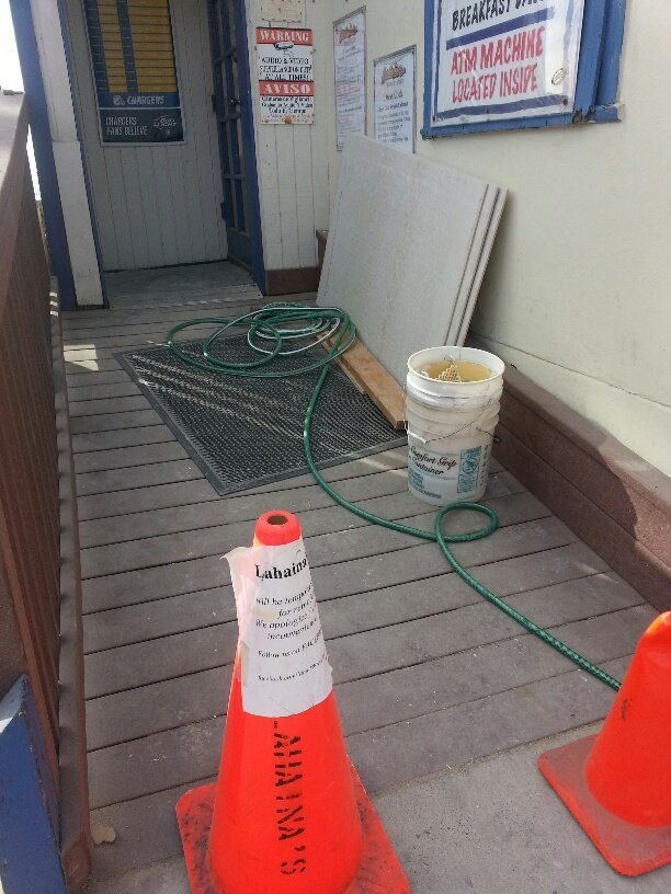 Back entrance of Lahaina displays Closed sign on cone