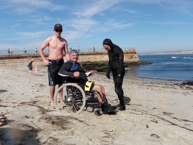 Paraplegic ocean swimmer can transition from his wheelchair into the ocean only at the Children's Pool behind the breakwater that creates a safety zone.