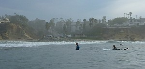 Tourmaline is a popular surf break. The storm drain is north of the parking lot (left side of photo).