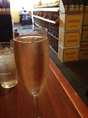 Brut rosé, and rows of wine available for retail purchase