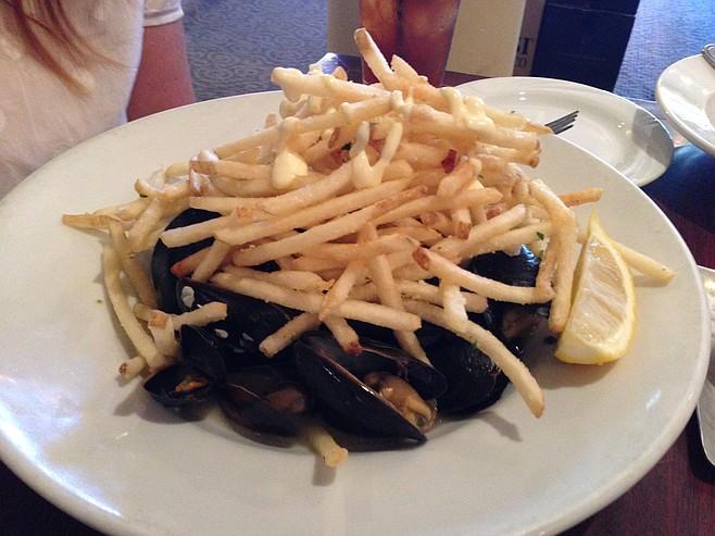 Mussels, hiding beneath fries