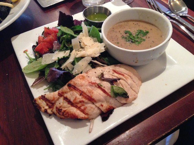 Cup of soup and house salad with chicken