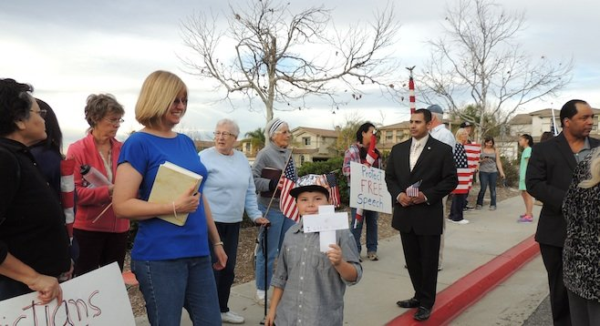 Protesters outside Helen Hunt Jackson Elementary School (Murrieta mayor pro tem Harry Ramos in the suit)