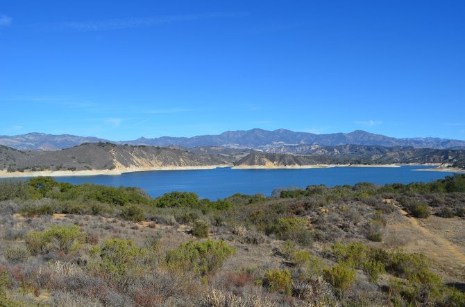 Lake Cachuma, located in the Santa Ynez Valley, central Santa Barbara County, off California State Route 154.  The Cachuma reservoir was created in 1953, when the US Bureau of Reclamation built Bradbury Dam.  Los Padres National Forest is behind the reservoir area.