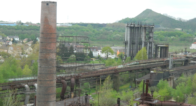 A historic ironworks overlooks the city of Saarbrücken on the French–German border.
