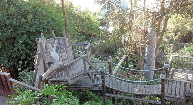Paths, bridges, and staircases wind through the gardens and terraces of the property's hillside yard.