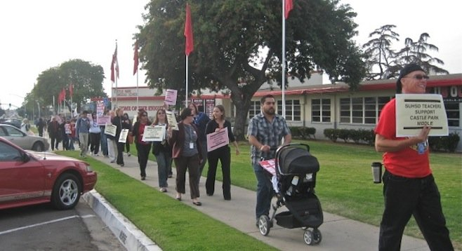 Teachers and supporters protest walk before January 23 meeting