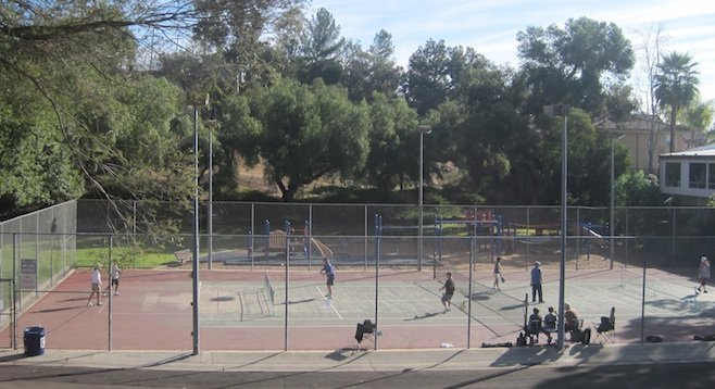 Pickleball players on temporarily converted tennis court