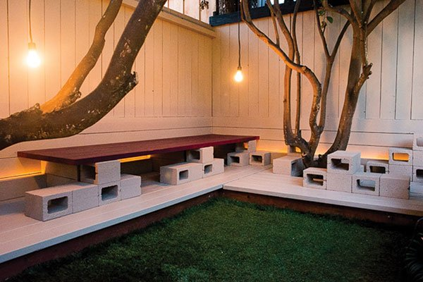 A deconstructed jack-o'-lantern and bench seats make for backyard whimsy and practicality.