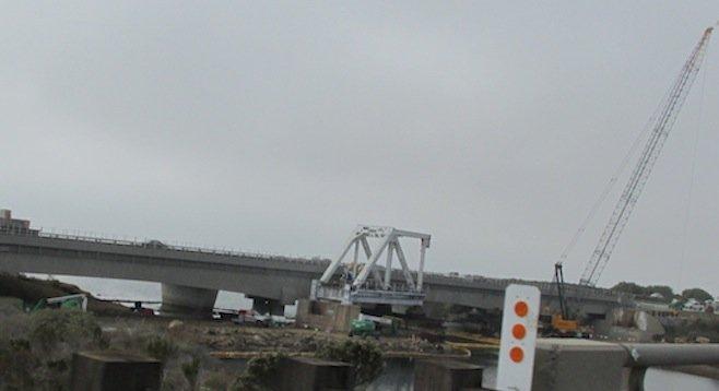 Old truss bridge segment in foreground