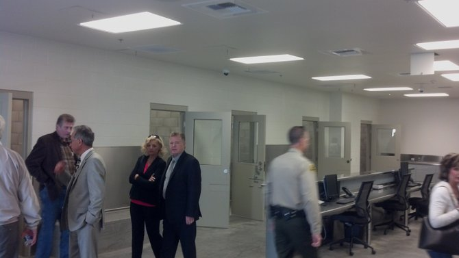 Visitors tour the jail cells at the back of the new facility