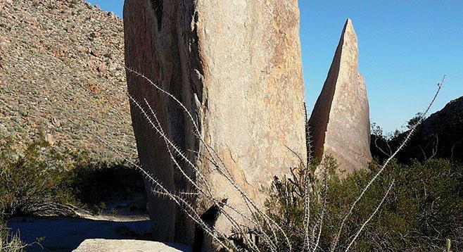 Split rock surrounded by bedrock mortars
