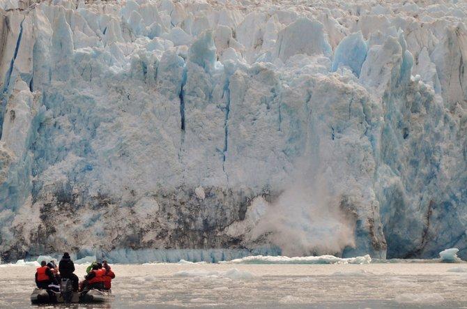 Skiff at glacier calving