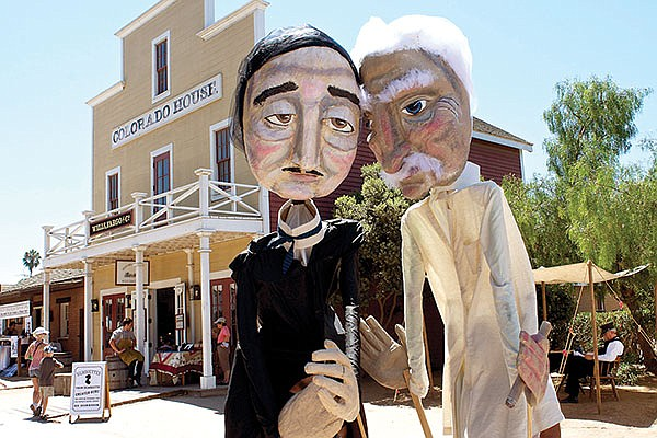 Write Out Loud's 14-foot-puppets, Edgar and Sam