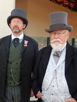 "Mr. James Keeline and Mr. George Lusk, pictured standing outside the Westfield mall in Carlsbad on Sunday 2/9/2014 about 1:15, just after they (and approx. 15 other ""steampunk"" hobbyists) were told they had to leave because of the way they were dressed, which as you can see, is exquisite! Photo taken by Mrs. Laura Lusk."
