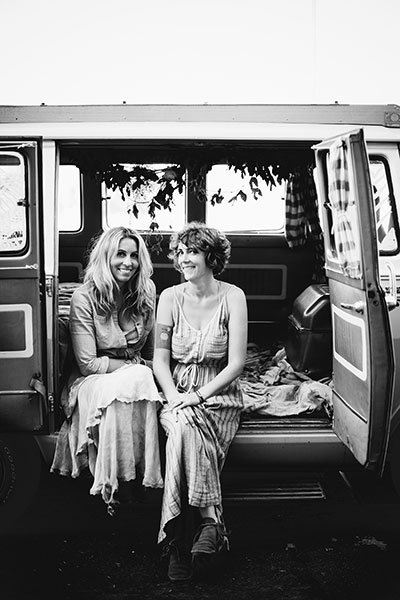 Torie Hendrix and Jamie Street perch in the Runaway Pop-Up Wedding van.