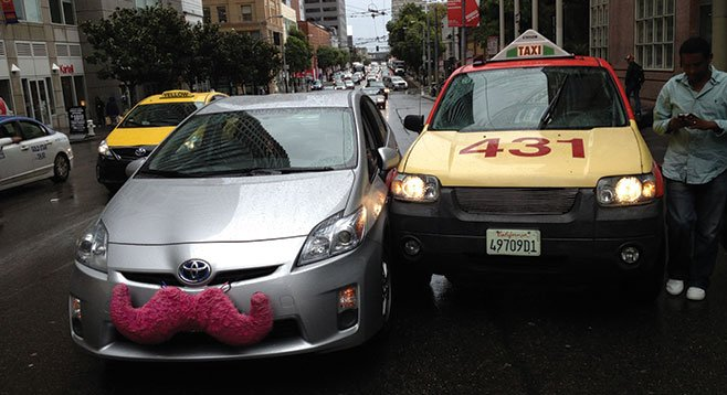 Lyft and Uber drivers report that taxi drivers have intentionally his their vehicles.