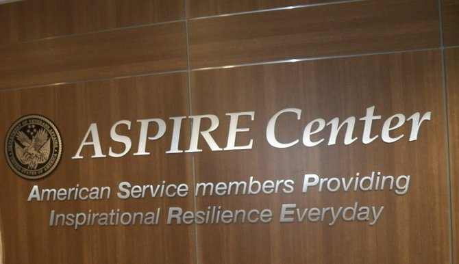 Department of Veterans Affairs Emblem and Aspire Center purpose explained.