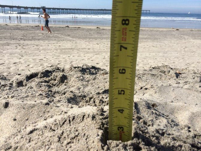 Measuring the sand in the 80 degree weather by San Diego Scenic Photography
