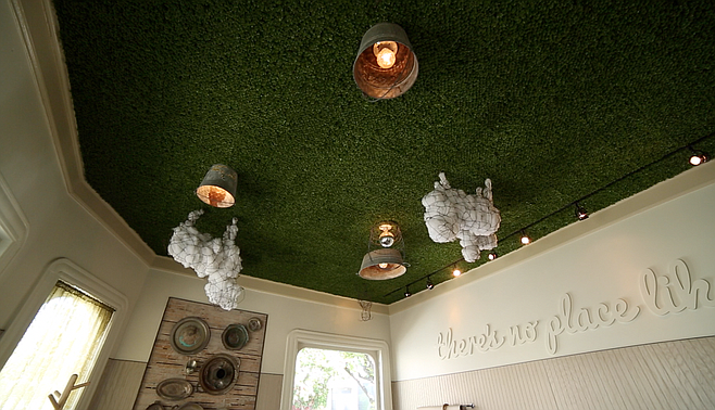 Check out the New Zealand pasture art on the ceiling in the front room.