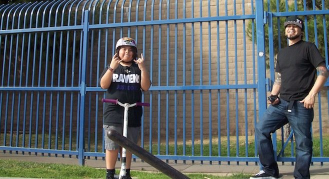 Maximus and his father Jesus Pelayo at the skate park