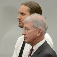 Lambesis w defense attorney. Photo Weatherston.