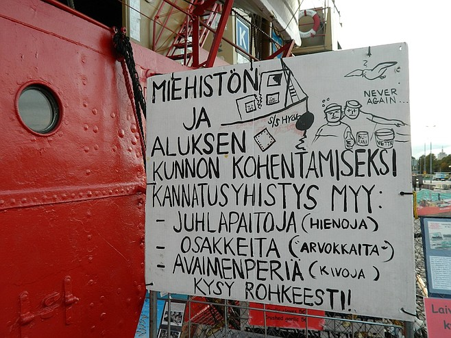 A sign at Lightship Helsinki, a 100-year-old mobile lighthouse that's now a bar and strange little museum in the harbor.