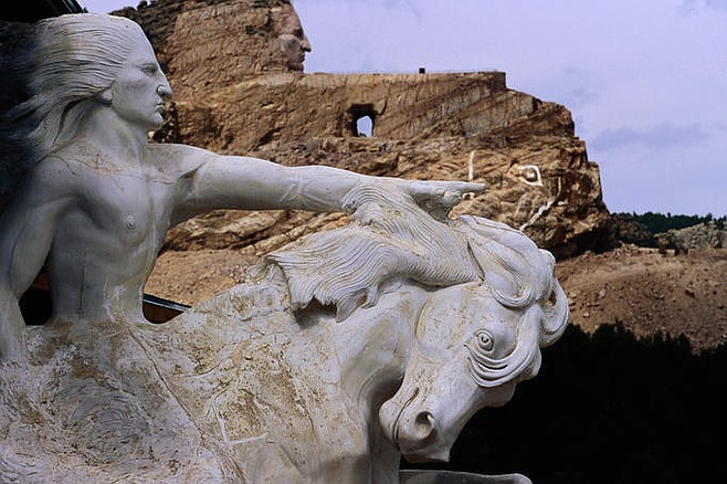 Crazy Horse Memorial. Foreground: What the completed monument will look like. Background: The work in progress.
