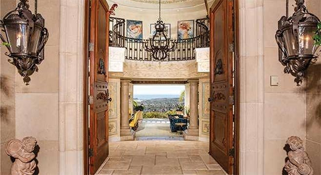 Pecan wood front doors, a grand rotunda foyer, and view over Batiquitos Lagoon and the Pacific to San Clemente Island are among the features of this Carlsbad estate.