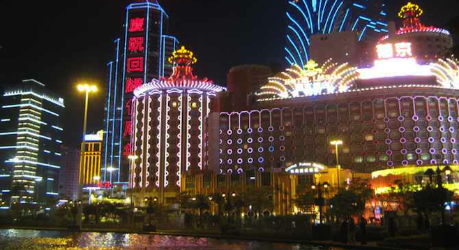 The bright lights of Macau's casino district at night.