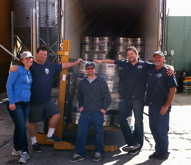 Jason Stockberger (center) in his new found Mike Hess Brewing Company glory.