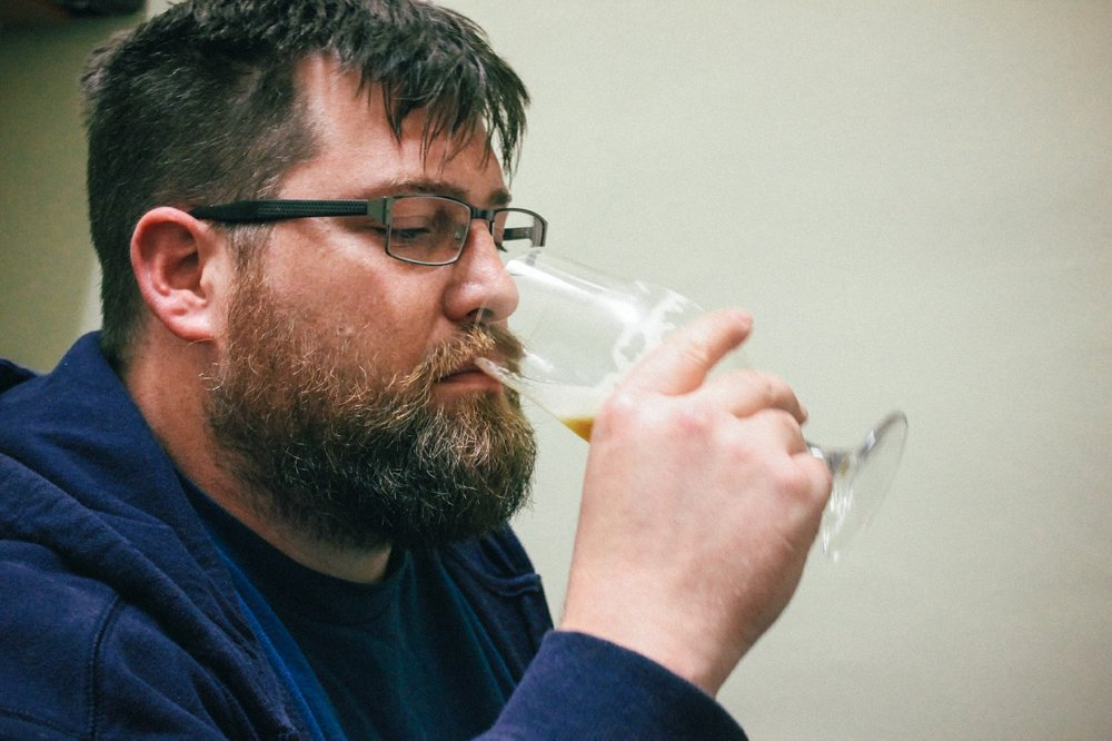 URBN St. Brewery brewmaster Callaway Ryan samples one of his early creations.