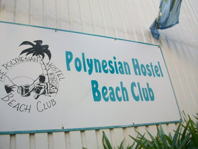 Hostel sign near Waikiki Beach in Oahu, Hawaii.