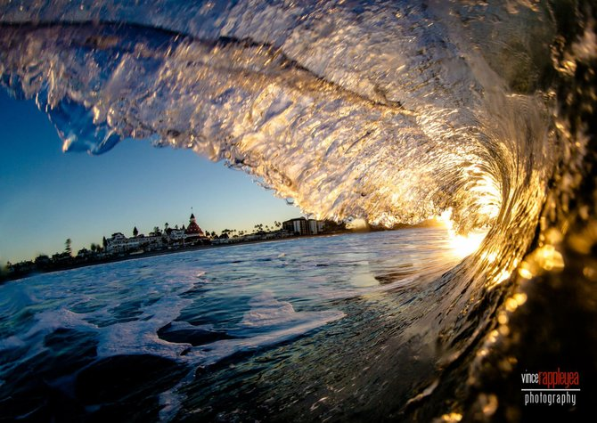 Waves at sunrise with a view of the Hotel Del Coronado by Vince Rappleyea.