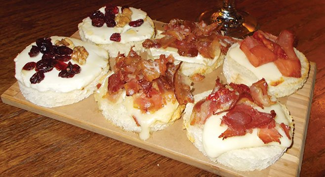 For $6, you six bruschettas — two with mozzarella, prosciutto, and grilled tomatoes; two with brie and slices of bacon; and the last two with goat cheese, cranberries, walnuts, and honey.