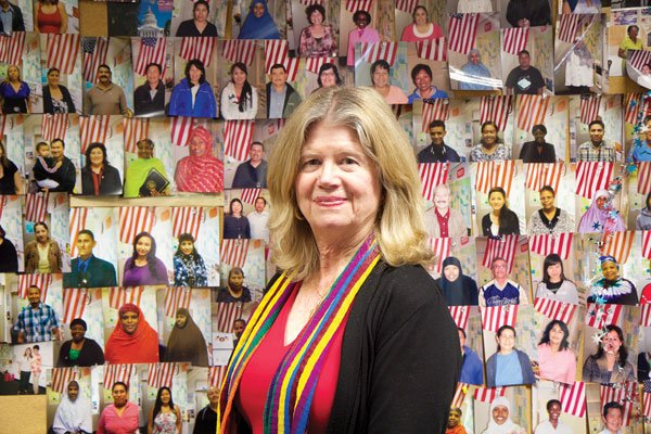 Gretchen Bitterlin in front of new U.S. citizens who completed Citizenship classes at Continuing Education's Mid-City campus.