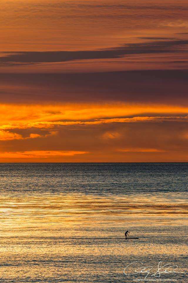 A lone SUP in Carlsbad by Andrew Shoemaker.