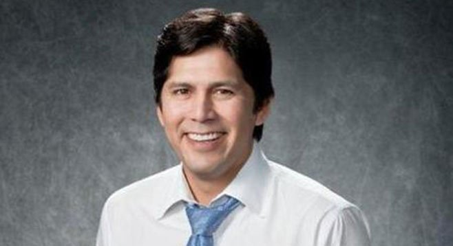 Free baseball tickets make state senator Kevin De Leon grin.